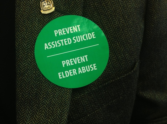 Sticker worn by an opponent of SB 220 during the bill's hearing on Monday